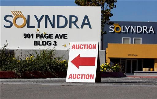 An auction sign is shown at bankrupt Solyndra headquarters in Fremont, Calif. Oct. 31, 2011 before Wednesday's auction. (AP Photo/Paul Sakuma)