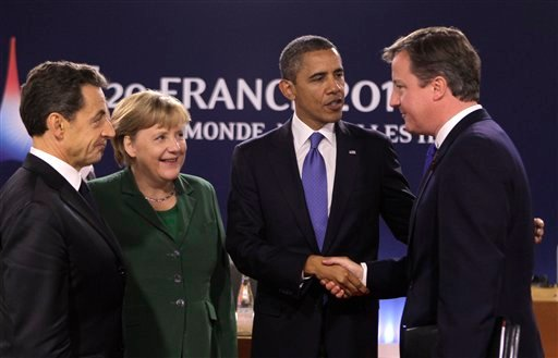 From the left, French President Nicolas Sarkozy, German Chancellor Angela Merkel, U.S President Barack Obama and British Prime Minister David Cameron react during a G20 meeting in Cannes Nov.3, 2011. U.S. (AP Photo/Michel Euler)