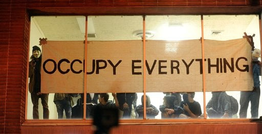 Occupy Oakland protesters claim a vacant building during a march on Wednesday, Nov. 2, 2011, in Oakland, Calif. (AP Photo/Noah Berger)