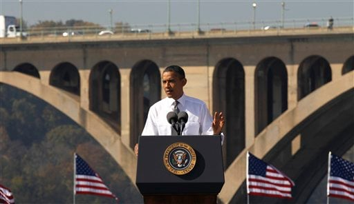 President Barack Obama speaks in front of the Key Bridge, which spans Arlington, Va. and Washington, Wednesday, Nov. 2, 2011, urging Congress to pass the infrastructure piece of the American Jobs Act.