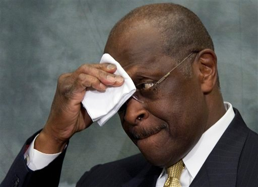 Republican presidential candidate Herman Cain wipes his brow as he speaks at the Congressional Health Caucus Thought Leaders Series, Wednesday, Nov. 2, 2011, on Capitol Hill in Washington.