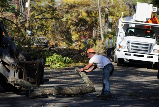 Workers remove trees around downed lines in Simsbury, Conn., Friday, Nov. 4, 2011.
