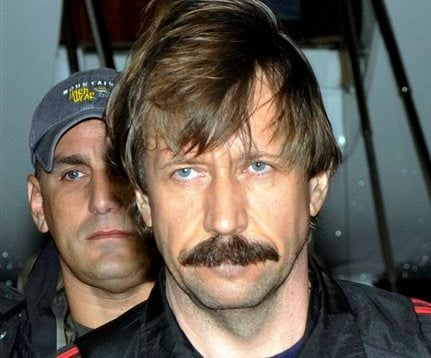 In this Tuesday Nov. 16, 2010 file photo provided by the Drug Enforcement Administration, Russian arms trafficking suspect Viktor Bout, is seen in U.S. custody after being flown from Bangkok to New York in a chartered U.S. plane. (AP)