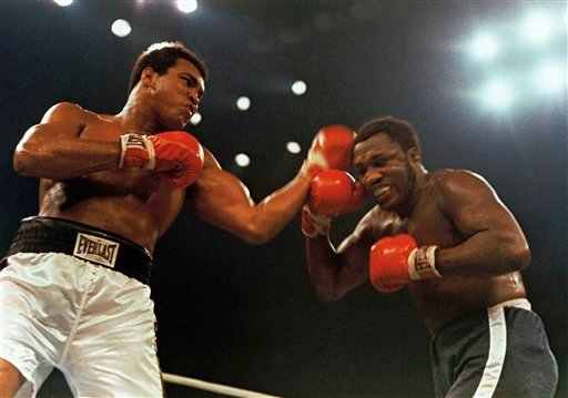 In this Jan. 28, 1974, file photo, Muhammad Ali, left, and Joe Frazier fight in a 12-round non-title fight at Madison Square Garden in New York.