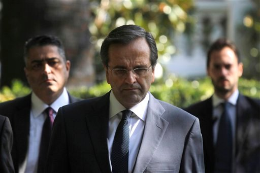 Greece's opposition leader Antonis Samaras leaves the Presidential Palace after meeting Greek president Karolos Papoulias, in Athens Sunday, Nov. 6, 2011. (AP)