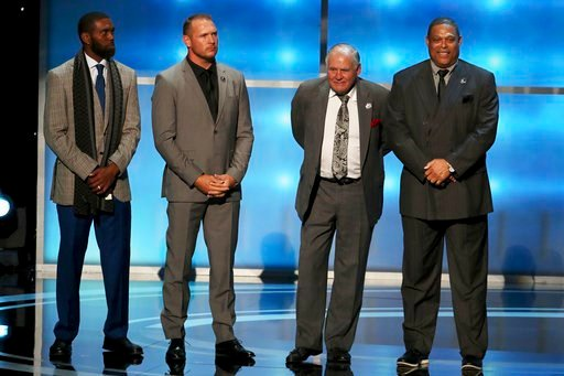 (L-R) Former NFL players Randy Moss, Brian Urlacher, Bobby Beathard, & Robert Brazile are announced as inductees into the Pro Football Hall of Fame at the 7th Annual NFL Honors on Saturday, Feb. 3, 2018. (Photo by Michael Zorn/Invision for NFL/AP Images)