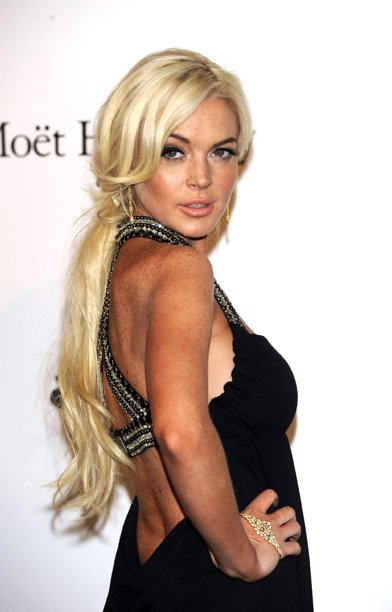 FILE -- In a Sept. 23, 2011 file photo Lindsay Lohan poses at the Amfar charity event in Milan, Italy.