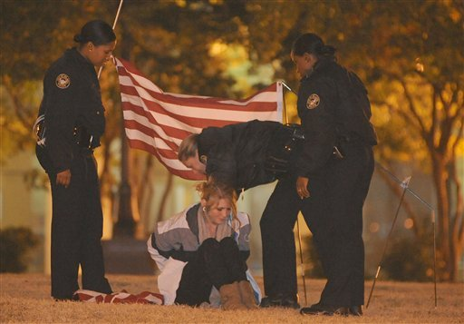 A lone member of the Occupy Atlanta movement is arrested by members of the Atlanta Police Department at Woodruff Park early on Monday, Nov. 7, 2011 in Atlanta. (AP)