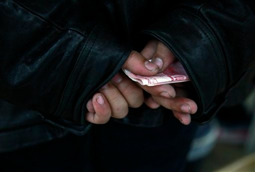 A Chinese man waits to contribute his money at the home of Chinese dissident artist Ai Weiwei in Beijing, China, Monday, Nov. 7, 2011. (AP)