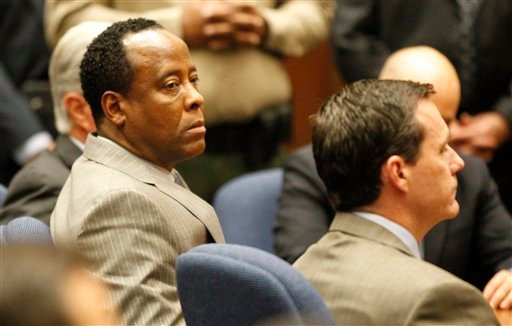 Dr. Conrad Murray listens as the jury returns with a guilty verdict in his involuntary manslaughter trial Monday, Nov. 7, 2011 in a Los Angeles courtroom.