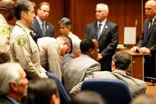 Dr. Conrad Murray is remanded into custody after the jury returns with a guilty verdict in his involuntary manslaughter trial Monday, Nov. 7, 2011 in a Los Angeles courtroom.