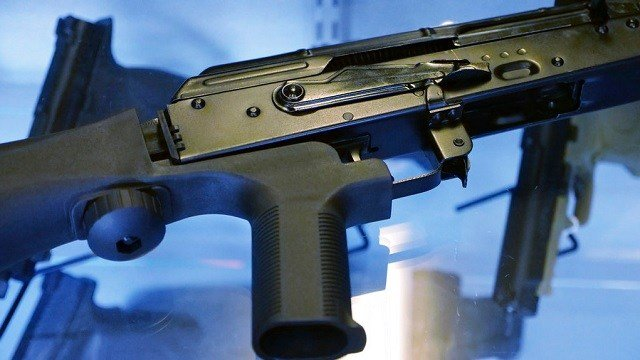 """a device called a """"bump stock"""" is attached to a semi-automatic rifle at the Gun Vault store and shooting range in South Jordan, Utah."""