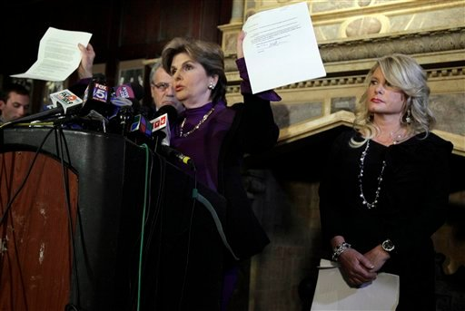 Attorney Gloria Allred holds up two sworn statements as Sharon Bialek, right, of the Chicago-area, looks on during a news conference at the Friars Club, in New York, Monday, Nov. 7, 2011.