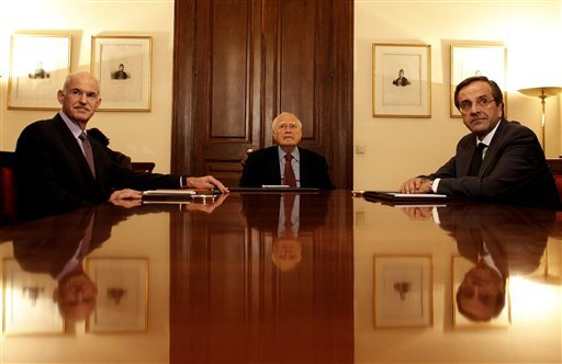 Greece's Prime Minister George Papandreou, left, Greek President Karolos Papoulias, center and opposition leader Antonis Samaras sit at the Presidential Palace in Athens on Sunday, Nov. 6 2011.