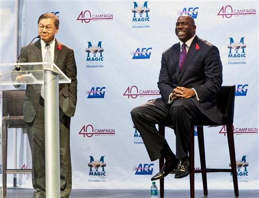 "AIDS expert Dr. David Ho, left, introduces Earvin ""Magic"" Johnson at the Magic Johnson Foundation ceremony in Los Angeles on Monday, Nov. 7, 2011."
