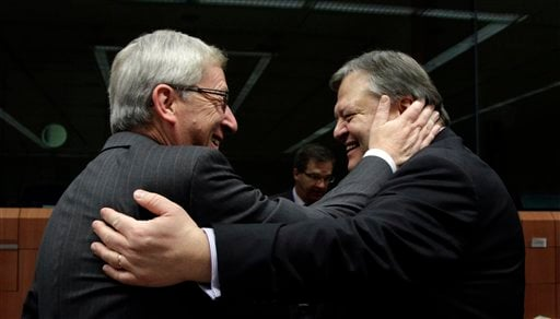 Luxembourg's Prime Minister Jean-Claude Juncker, left, greets Greek Finance Minister Evangelos Venizelos during a meeting of eurozone finance ministers at the EU Council building in Brussels on Monday, Nov. 7, 2011. (AP)