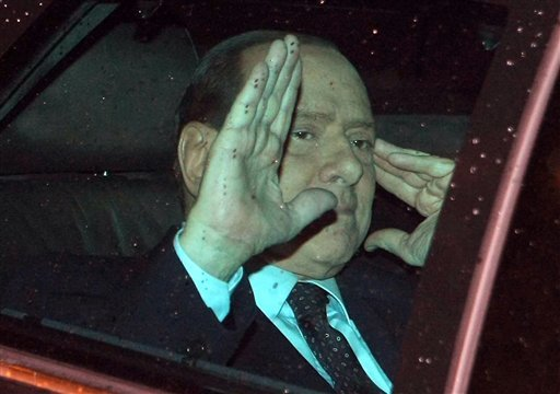 Italian Premier Silvio Berlusoni waves to journalists as he leaves the Quirinale, Presidential palace, after meeting with Italian President Giorgio Napolitano, in Rome, Tuesday, Nov. 8, 2011. (AP Photo/Roberto Monaldo, LaPresse)