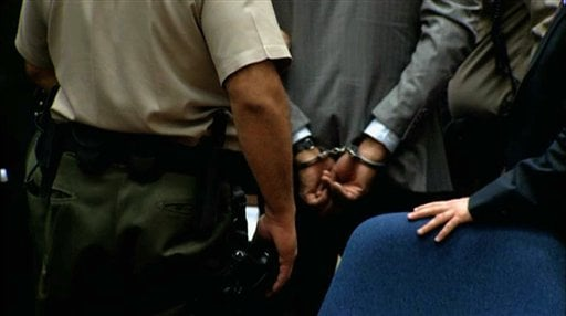 In this frame grab from video, deputies place handcuffs on Dr. Conrad Murray after his conviction on involuntary manslaughter charges in the death of pop star Michael Jackson, in Los Angeles Superior Court Monday, Nov. 7, 2011.