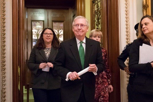 Senate Majority Leader Mitch McConnell, R-Ky., leaves the chamber after announcing an agreement in the Senate on a two-year, almost $400 billion budget deal.