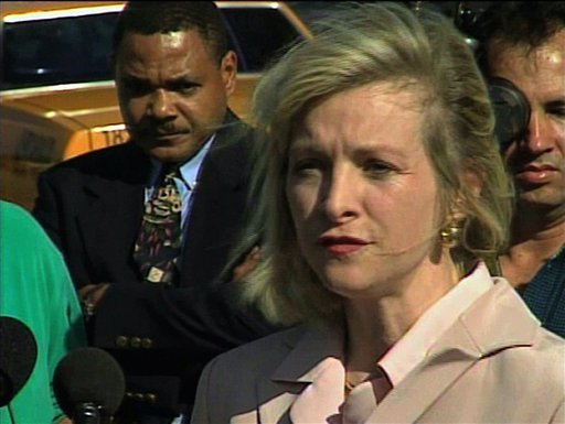 FILE - This March 2000 image from video shows then-Immigration and Naturalization Service spokesperson Karen Kraushaar at a news conference in Miami regarding Elian Gonzalez.