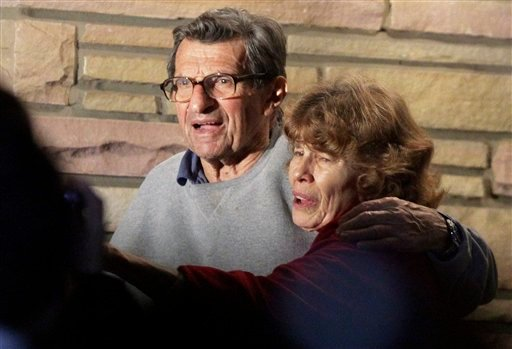 Joe Paterno and his wife Susan stand on their porch to thank well-wishers gathered outside in State College, Pa., Wednesday, Nov. 9, 2011.