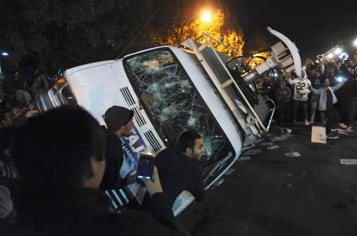 Penn State students flip a television news van during a riot after it was announced that Joe Paterno would no longer be head coach of Penn State Football on Wednesday, Nov. 9, 2011.