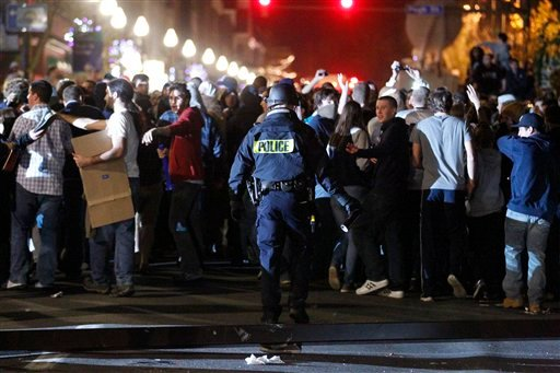 Police hold back students after they reacted off campus Thursday, Nov. 10, 2011, in State College, Pa. to Penn State board of trustees firing of football coach Joe Paterno Wednesday.