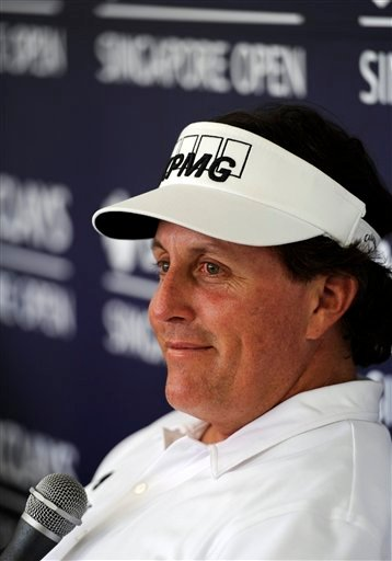 U.S. golfer Phil Mickelson listens to a reporter's questions during a press conference in Singapore Wednesday, Nov. 9, 2011. Mickelson said he's ready to show off improved play at this week's Singapore Open golf tournament.