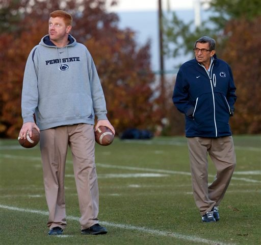 Penn State football coach Joe Paterno, right, and assistant coach Mike McQueary walk the field during practice, Wednesday, Nov. 9, 2011, in State College, Pa. (AP Photo/The Citizens' Voice, Michael R. Sisak)