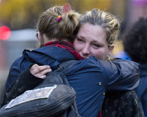 Amanda Thayer, 29, of Burlington, Vt., is consoled after police respond to a shooting at the Occupy Burlington encampment at City Hall Park on Thursday Nov. 10, 2011. (AP)