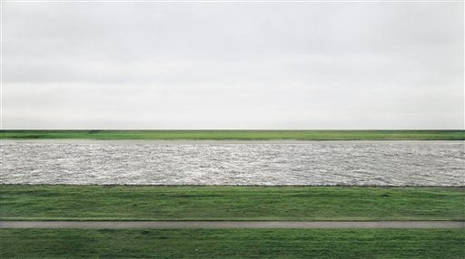 """This 1999 photograph provided by Chrisitie's shows the Rhine river by German artist Andreas Gursky. Titled """"Rhein II,"""" the chromogenic color print face-mounted to acrylic glass was sold for $4.3 million Tuesday, Nov. 8, 2011."""