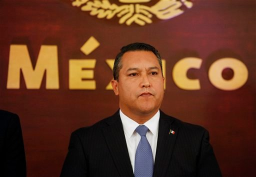 In this Wednesday July 14, 2010, Mexico's Interior Minister Francisco Blake Mora attends his his swearing in ceremony at Los Pinos presidential residence in Mexico City. (AP Photo/Eduardo Verdugo, File)