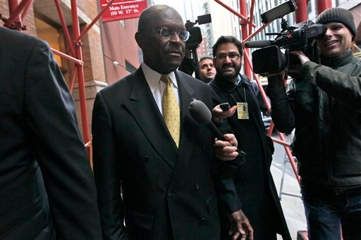 Republican presidential candidate Herman Cain is pursued by reporters as he leaves a fundraiser at the Russian Tea Room, Friday, Nov. 11, 2011, in New York.