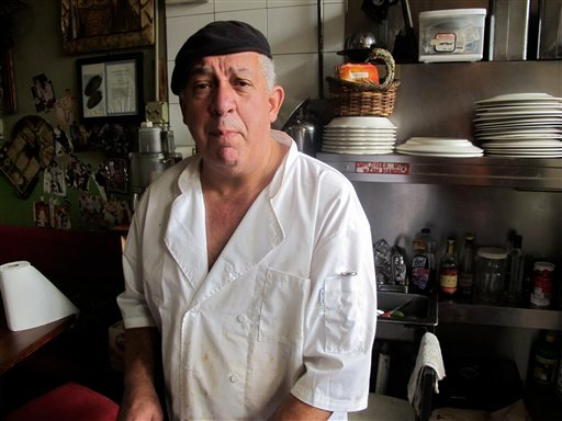 In this Oct. 25, 2011 photo, Ali A El Sayed, owner of the Kabab Café in the Astoria neighborhood of New York City, discusses the New York Police Department surveillance program that targets Muslims and Arabs, often with no evidence of wrongdoing. (AP)