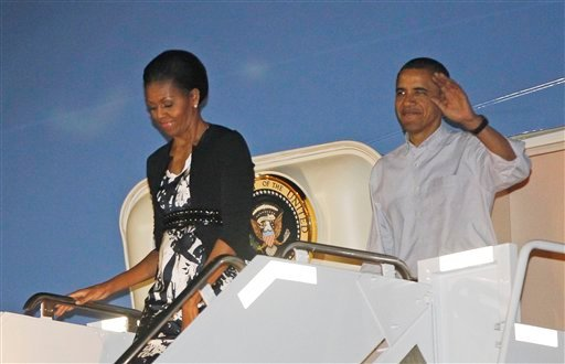 President Barack Obama and first lady Michelle Obama disembark Air Force One as they arrive at Hickam Air Force Base in Honolulu, Hawaii, where they will host the APEC summit, Friday, Nov. 11, 2011. (AP Photo/Charles Dharapak)