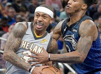 Cleveland Cavaliers guard Isaiah Thomas (3) drives to the basket in front of Orlando Magic guard Elfrid Payton (2), right, during the first half of NBA basketball game Tuesday, Feb. 6, 2018, in Orlando, Fla.