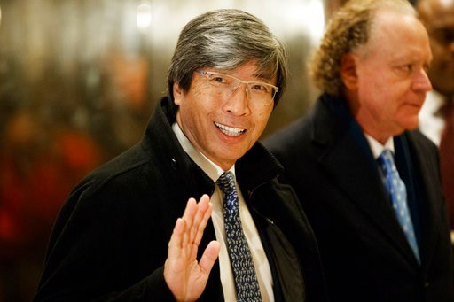 In this Jan. 10, 2017, file photo, pharmaceuticals billionaire Dr. Patrick Soon-Shiong waves as he arrives in the lobby of Trump Tower in New York for a meeting with President-elect Donald Trump.