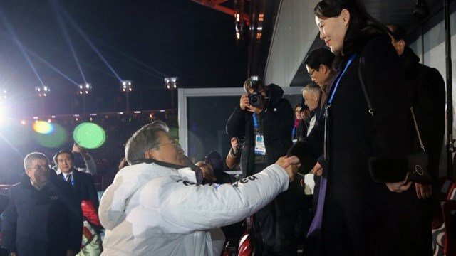 South Korean President Moon Jae-in, left, shakes hands with North Korean leader Kim Jong Un's younger sister Kim Yo Jong during the opening.
