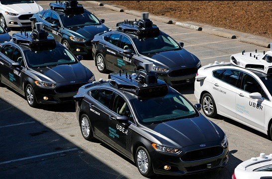 Uber vehicles position themselves to take journalists on rides during a media preview at Uber's Advanced Technologies Center in Pittsburgh.