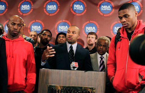 Surrounded by NBA players, including New York Knicks' Chauncy Billups, left, and Oklahoma City Thunder's Russell Westbrook, right, NBA Players Association president Derek Fisher speaks during a news conference after a meeting of the players' union. (AP)