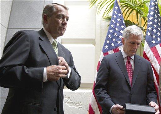House Speaker John Boehner of Ohio, left, and House Majority Whip Kevin McCarthy, R-Calif., wait to speak to media on Capitol Hill in Washington, Tuesday, Nov. 15, 2011.