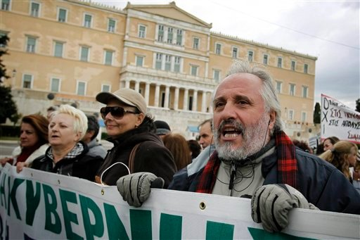 Greek public sector employees protest against the austerity measures outside the Greek parliament in Athens, on Tuesday, Nov. 15, 2011.