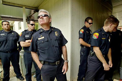 Bill Clayton examines a homeowner's backyard Sept. 29, 2004, in the Lawrence Welk Resort Villas north of Escondido, Calif. (AP Photo/Ric Francis)