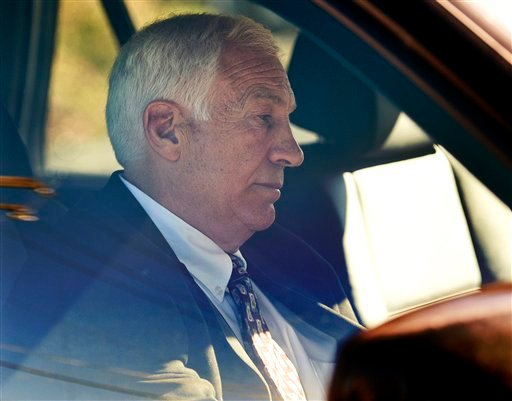 "In this Nov. 5, 2011 file photo, former Penn State football defensive coordinator Gerald ""Jerry"" Sandusky sits in a car as he leaves the office of Centre County Magisterial District Judge Leslie A. (AP Photo/The Patriot-News, Andy Colwell, File)"