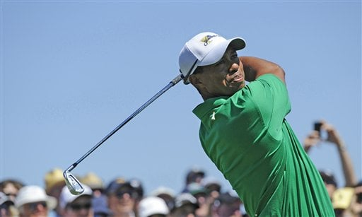Tiger Woods of the U.S. team hits an approach shot during a practice round prior to the start of the Presidents Cup golf tournament at Royal Melbourne Golf Course, in Melbourne, Australia, Tuesday, Nov. 15, 2011.