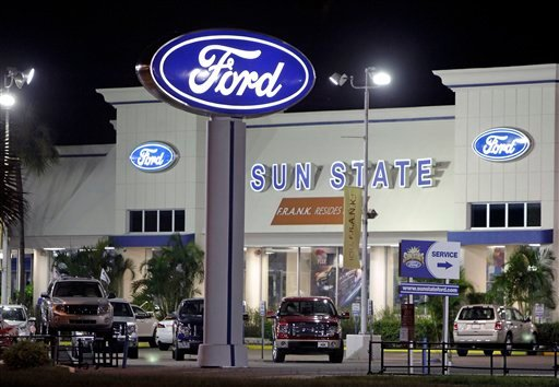 In this photo taken on Tuesday, Aug. 30, 2011, new cars are seen on display at a Ford Dealership in Orlando, Fla. November is shaping up to be the strongest month for U.S. auto sales this year as more Americans decide to replace aging cars and trucks.