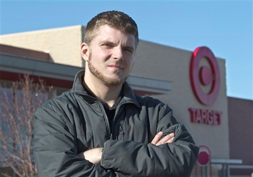 Anthony Hardwick, a part-time employee at a north Omaha Target store, poses for a photo in front of his place of employment, in Omaha, Neb., Tuesday, Nov. 15, 2011.