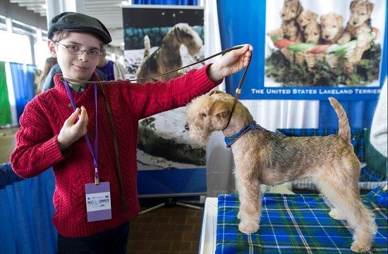 Fenric Towell poses for a photo with his lakeland terrier Missy during the meet.
