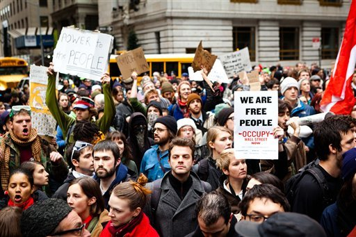 Occupy Wall Street protestors march through lower Manhattan in search for an entrance to a police barricaded Wall Street, Thursday, Nov. 17, 2011, in New York. (AP Photo/John Minchillo)