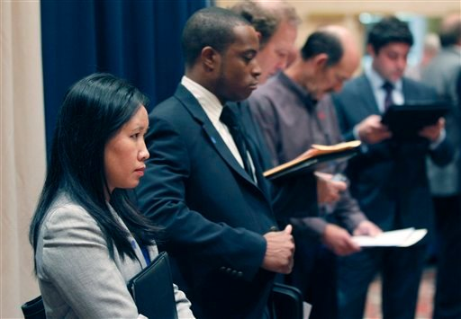 In this Nov. 14, 2011 photo, job seekers line up to speak to recruiters during a career expo in Las Colinas, Texas. (AP Photo/LM Otero)